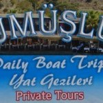 Gumusluk Day Boat Trip sign