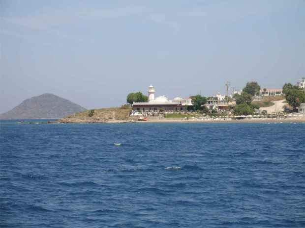 Fener Lighthouse and Beach in Turgutreis, Turkey from a boat