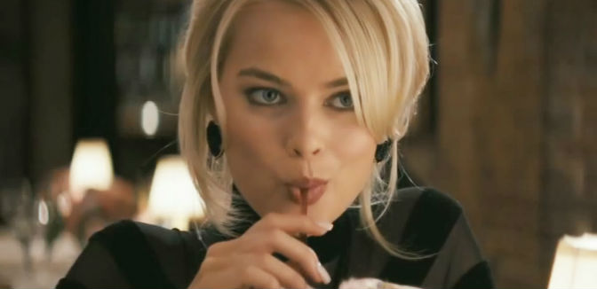 Margot Robbie drinking from straw