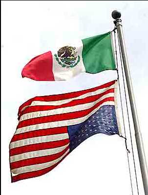 mexican-flag-flying-above-upside-down-american-flag