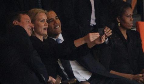 Obama hamming it up at Mandela memorial