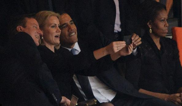 Obama hamming it up at Mandela memorial