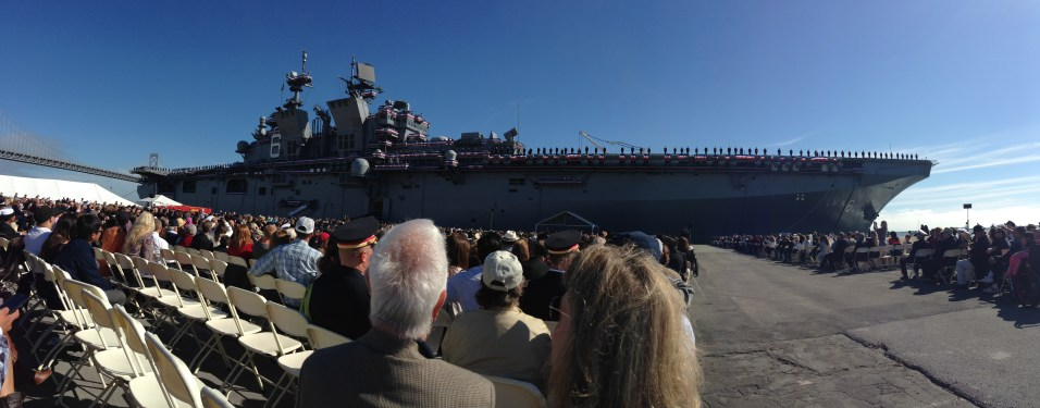 The crew mans the port side of the USS America, having brought the ship to life at its commissioning.