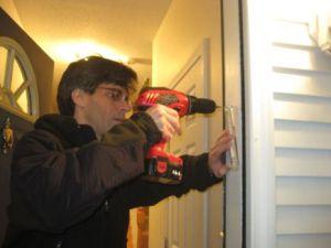 Putting Mezuzah on door