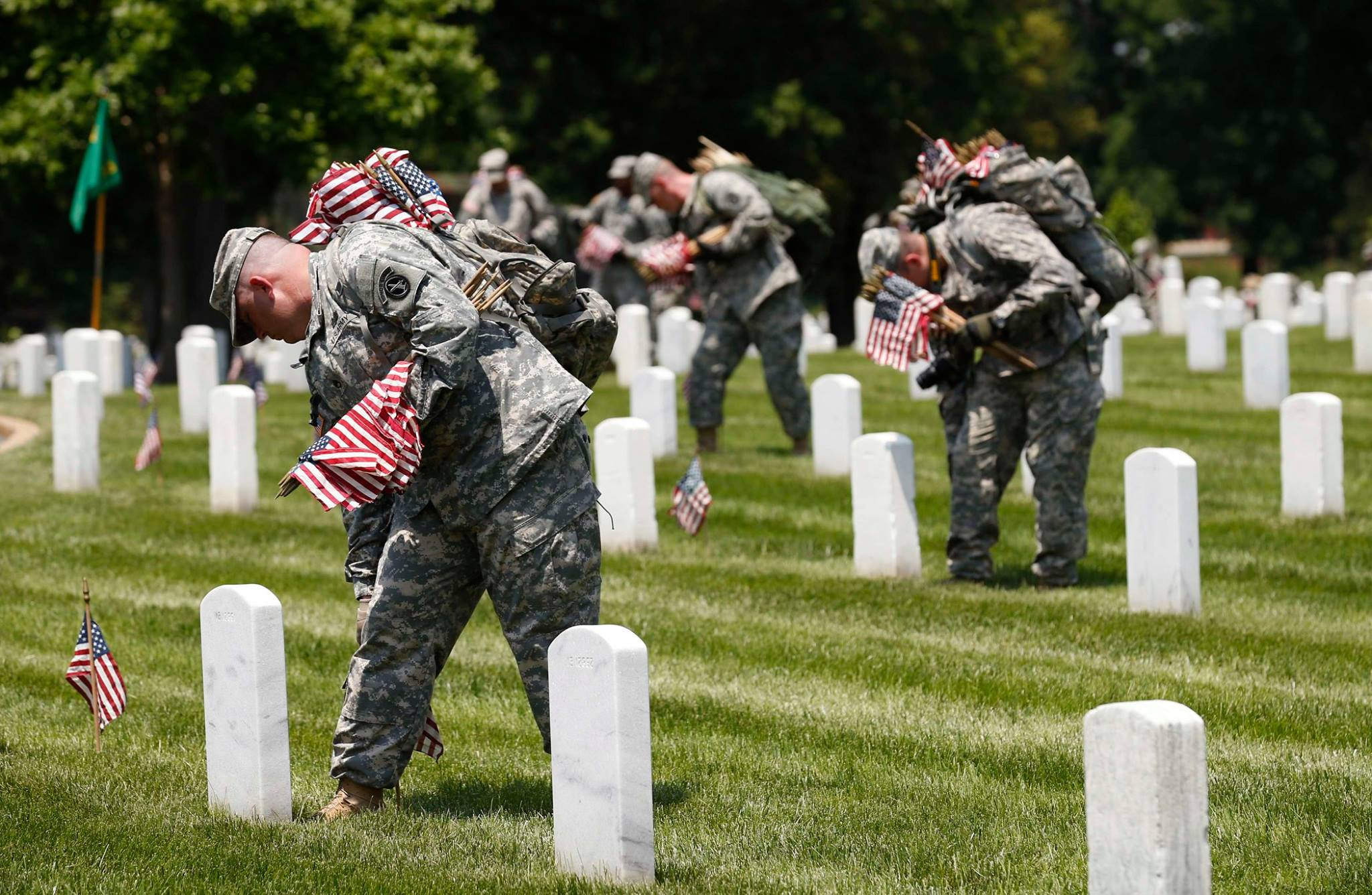 Military planting flags on Memorial Day