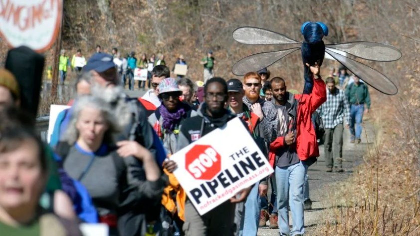 Protesters march in Cummington, Mass, against the Kinder Morgan natural gas pipeline proposed for Western Massachusetts, Thursday, March 17, 2016. (Ben Garver/The Berkshire Eagle via AP)