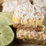 Perfect treat for Cinco De Mayo! A coconut shortbread crust with a tequila lime filling and topped off with more toasted coconut!
