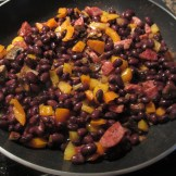 Chopped color peppers with sausage and black beans