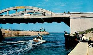 A view of the original bridge over the inlet, sometimes called Rainbow Bridge or Old McDonald Bridge for its twin arches