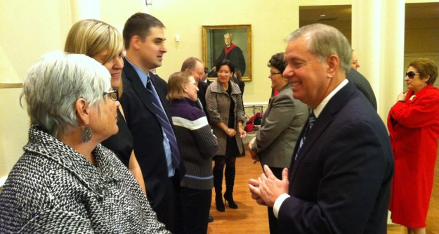Lindsey Graham pays respects to Mary Bandy and other members of the family on Saturday.