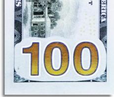100_bill_back-565x246