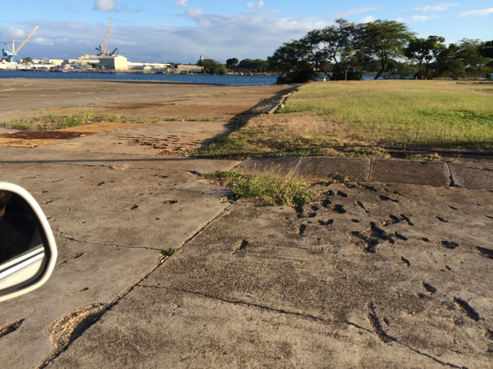 The pockmarks in the concrete outside were caused by a Japanese bomb.