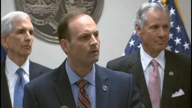 Wilson, flanked by ex-AGs Charlie Condon and Henry McMaster, during his raging presser back in March.