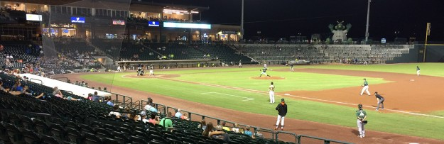 The underpaid Augusta Greenjackets take the field against the Fireflies in Columbia Monday night. The home team won, 7-4.