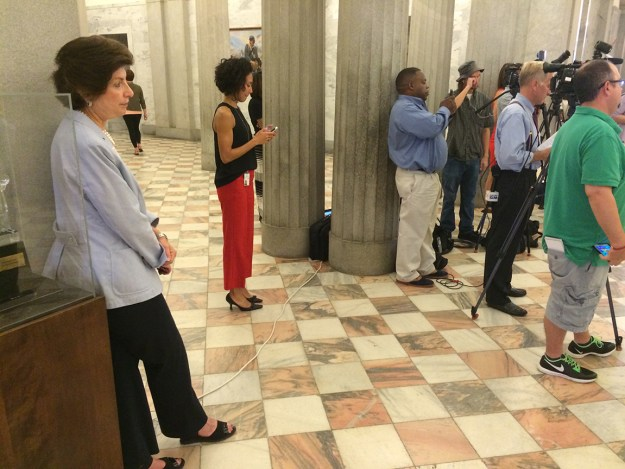 Susan Brill, Senate candidate, watches as members of the Richland County delegation call on RCRC members to resign.