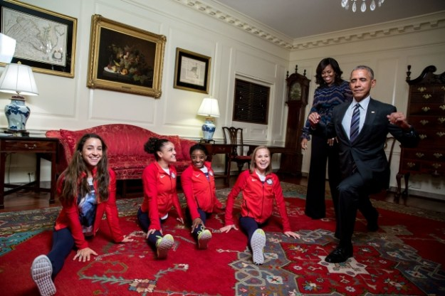 President Barack Obama attempts his best split with the gold medal 2016 U.S. Olympic Women's Gymnastics Team with First Lady Michelle Obama watching in the Map Room, prior to an event to welcome the 2016 U.S. Olympic and Paralympic teams to the White House to honor their participation and success in the 2016 Olympic games in Rio de Janeiro, Brazil, Sept. 29, 2016. (Official White House Photo by Pete Souza)