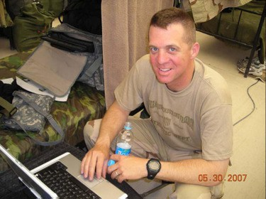 Capt. Smith writing home from Afghanistan in 2007.