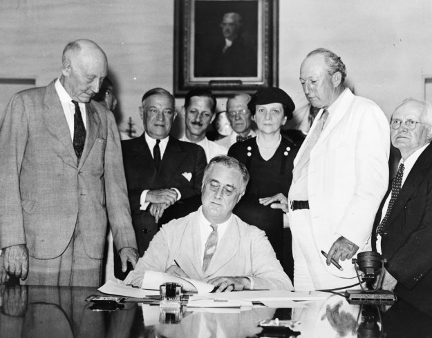 FDR signing the Social Security Act.