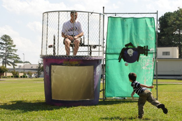 Command Chief Master Sgt. Greg Nelson sits in the dunking booth at the 916th Air Refueling Wing Family Day held on Oct. 3. U.S. Air Force photo by TSgt. Gillian Albro, 916ARW/PA.