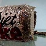 [image: a gem-encrusted diet coke can purse]