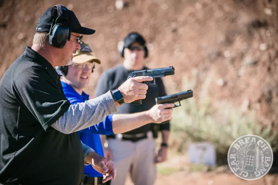 Leatham teaching a student how to manipulate a gun for better reloads