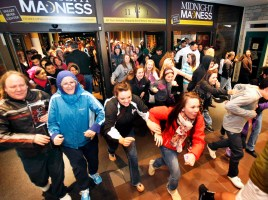 Black Friday shoppers pour into the Valley River Center mall for the Midnight Madness sale Friday, Nov. 23, 2012 in Eugene, Ore. For decades, stores have opened their doors in wee hours of the morning on the day after Thanksgiving known as Black Friday. But this year, that changed when major chains from Target to Toys R Us opened on Thanksgiving itself, turning the traditional busiest shopping day of the year into a two-day affair. (AP Photo/The Register-Guard, Brian Davies)