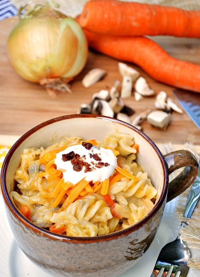 This Gluten Free Carrot Cheddar Mac n' Cheese is slightly healthier than the alternative, using lowfat milk, Greek yogurt, and lots of veggies!