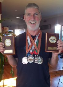 Cubby Haus founder Malcolm Sachs with  amateur brewing gongs