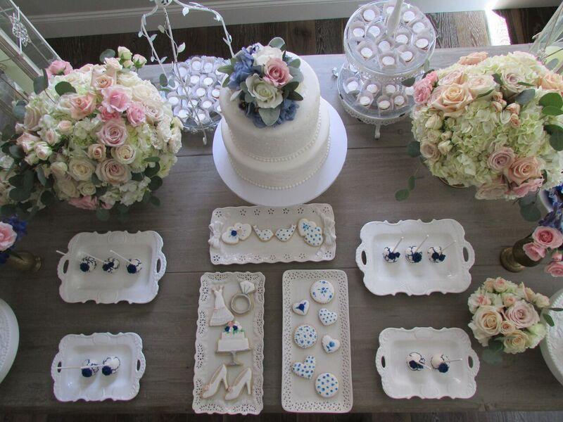 elegant floral outdoor bridal shower dessert table