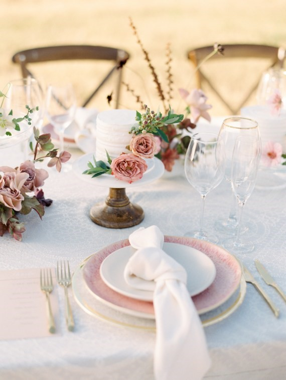 Dreamy Outdoor Bridal Shower table arragement with floral