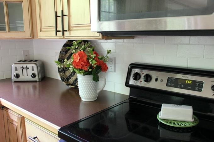 How to paint a tile backsplash bright green door for Can you paint over glass tile backsplash