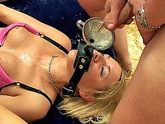 Sandie Caine drinking cum through a funnel