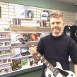 Brixton store - Russell Lewendon with guitar (landscape)