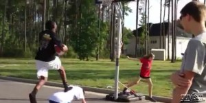 Kid slams into basketball pole in ultimate dunk FAIL