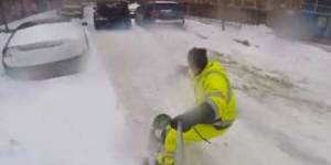 This guy snowboarding through NYC had the best snow day ever