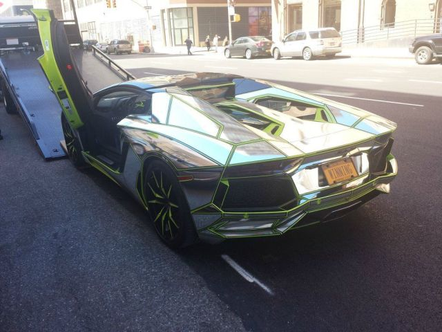 chrome-lamborghini-getting-towed