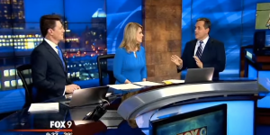 Watch This Weatherman Realize He Left A Hanger Inside His Suit While Live On-Air