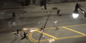 Watch Kids Have A Massive Roman Candle War In The Middle Of A Chicago Street While Yelling 'F*ck The Police'