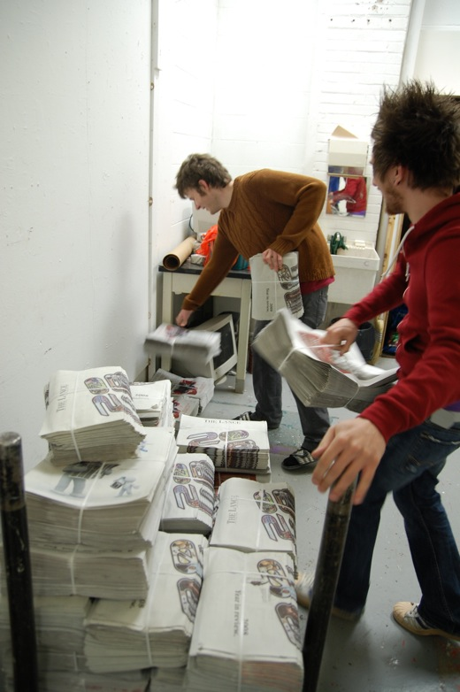 Stacking newspapers in my studio