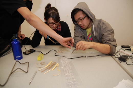 Josh, Danielle, and Immony working on soldering
