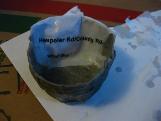 making a planter from paper, then adding a magnet, then adding wheat paste
