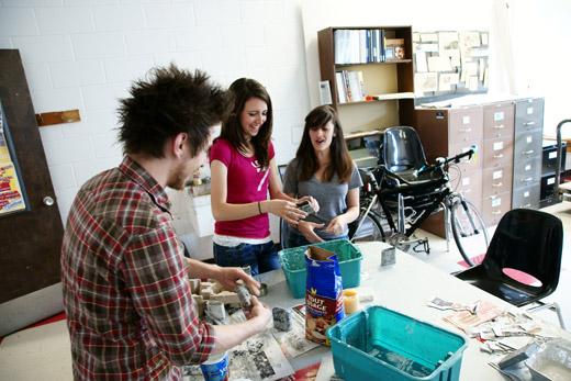 Justin, Ethina, Rosina repairing planters