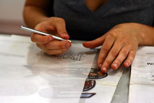Rosina cuts a stencil