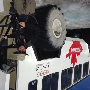 Steve boarding the bus from trip to glacier provides context for size of bus
