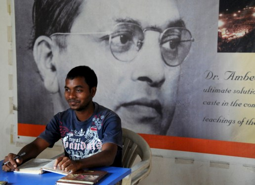 A student of Ambedkar sits before a poster of the leader of ex-untouchables. Photo by Alan Senauke.