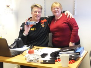 Head of youth, John Bastian, receives camcorder from BullBuilder board member, Jen Bennison.