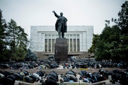 During Eid ul-Fitr, several thousand Muslims pray in front of the parliament building and a statue of Lenin in Bishkek.