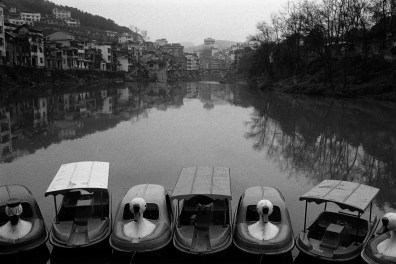 Boat rides sit idle during winter months in Jishou City, China 2006.