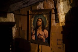 A portrait of Jesus hangs in a Roma home in the Stara Gazela camp, which was to be destroyed by city government to make way for the reconstruction of a central bridge in Belgrade.