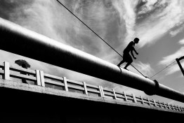 ECUADOR, DECEMBER 2011. EL ENO. A young man jumps from an oil pipeline. The Oil pipeline called SOTE (Trans-Ecuadorian Pipeline System) crosses the entire country to carry crude a distance of 503 km (310 miles) from the Amazon to the Pacific coast.